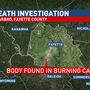 Death investigation underway after body was found in burning car in Fayette County