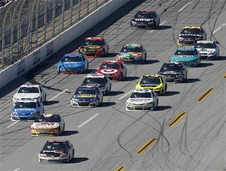 Denny Hamlin (11) heads to the finish line during the NASCAR Aaron's 499 Sprint Cup series auto race at Talladega Superspeedway, Sunday, May 4, 2014, in Talladega, Ala. Hamlin won the race. (AP Photo/John Bazemore)