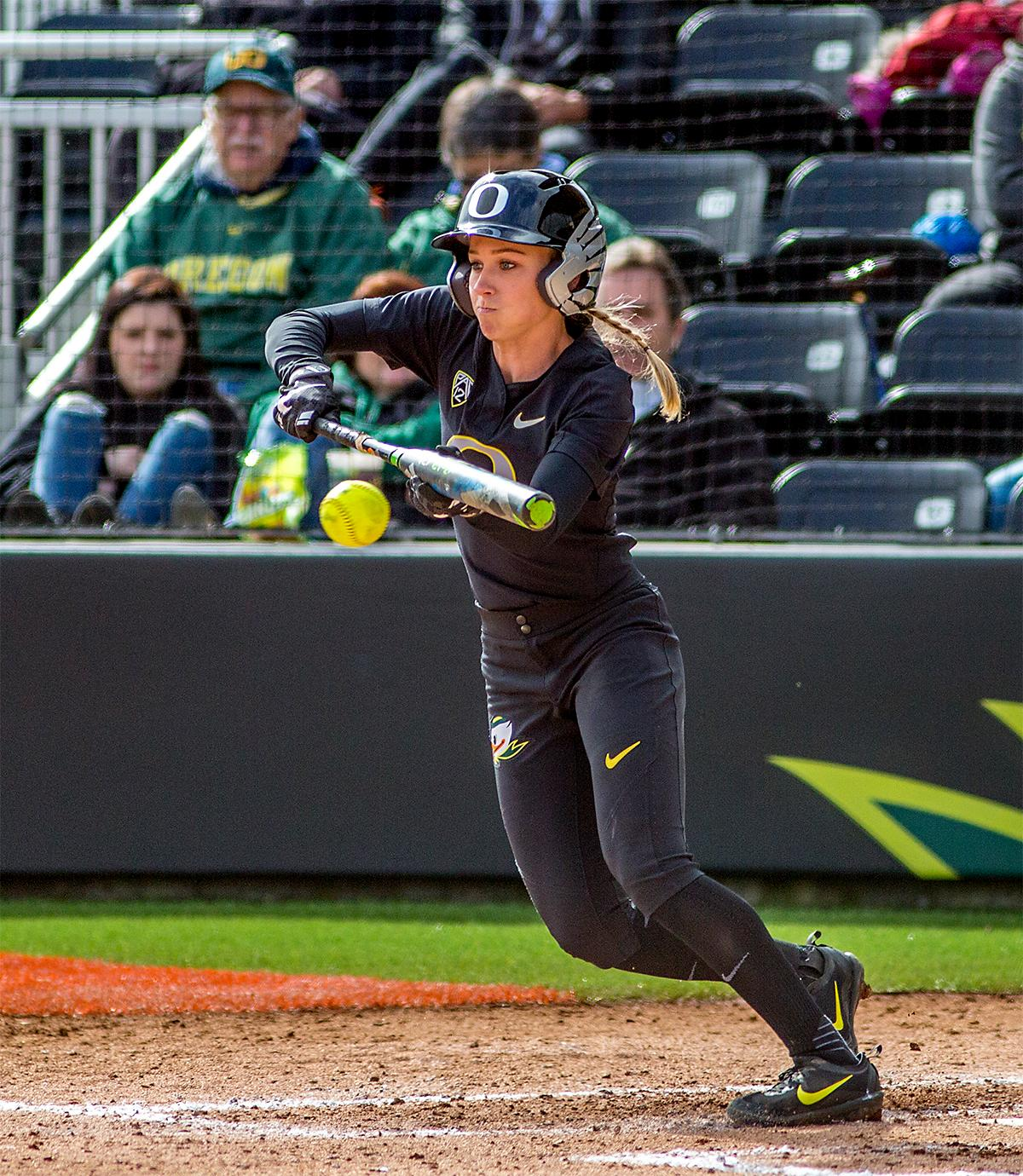 The Duck's Alexis Mack (#10) bunts the ball. The Oregon Ducks defeated the Cal Golden Bears 2-1 in the second game of the three game series. Photo by August Frank, Oregon News Lab