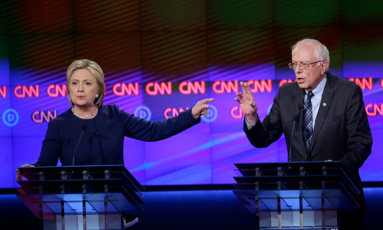 Democratic presidential candidates Hillary Clinton, left, and, Sen. Bernie Sanders, I-Vt., argue a point during a Democratic presidential primary debate at the University of Michigan-Flint, Sunday, March 6, 2016, in Flint, Mich. (AP Photo/Carlos Osorio)