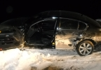 A suspect's car is on its side March 3, 2014, after a 45-mile chase through three counties. (Fond du Lac Co. Sheriff's Office)