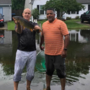 Virginia Beach man catches fish in flooded street