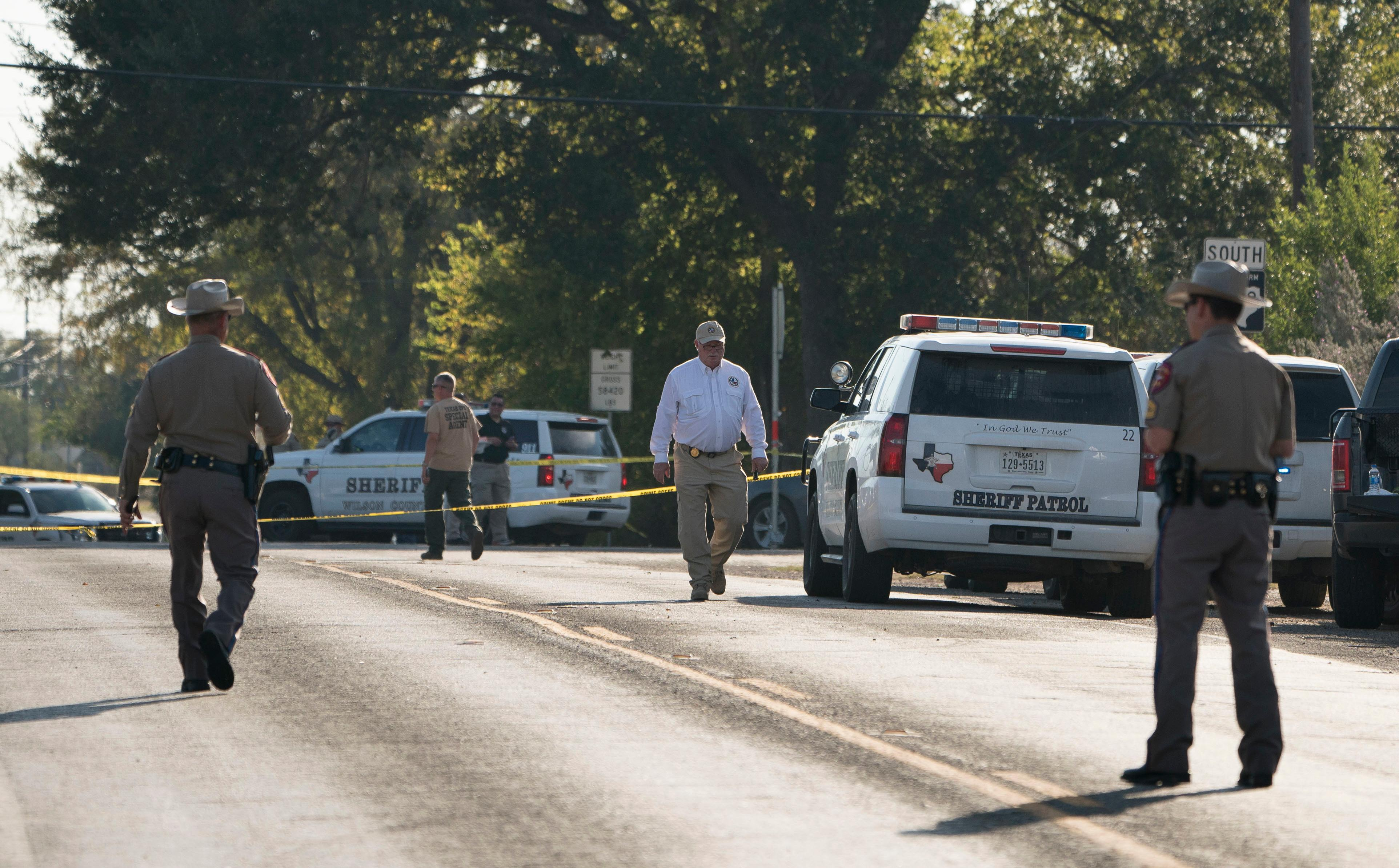 Law enforcement officers work near the First Baptist Church of Sutherland Springs after a fatal shooting, Sunday, Nov. 5, 2017, in Sutherland Springs, Texas. (AP Photo/Darren Abate)