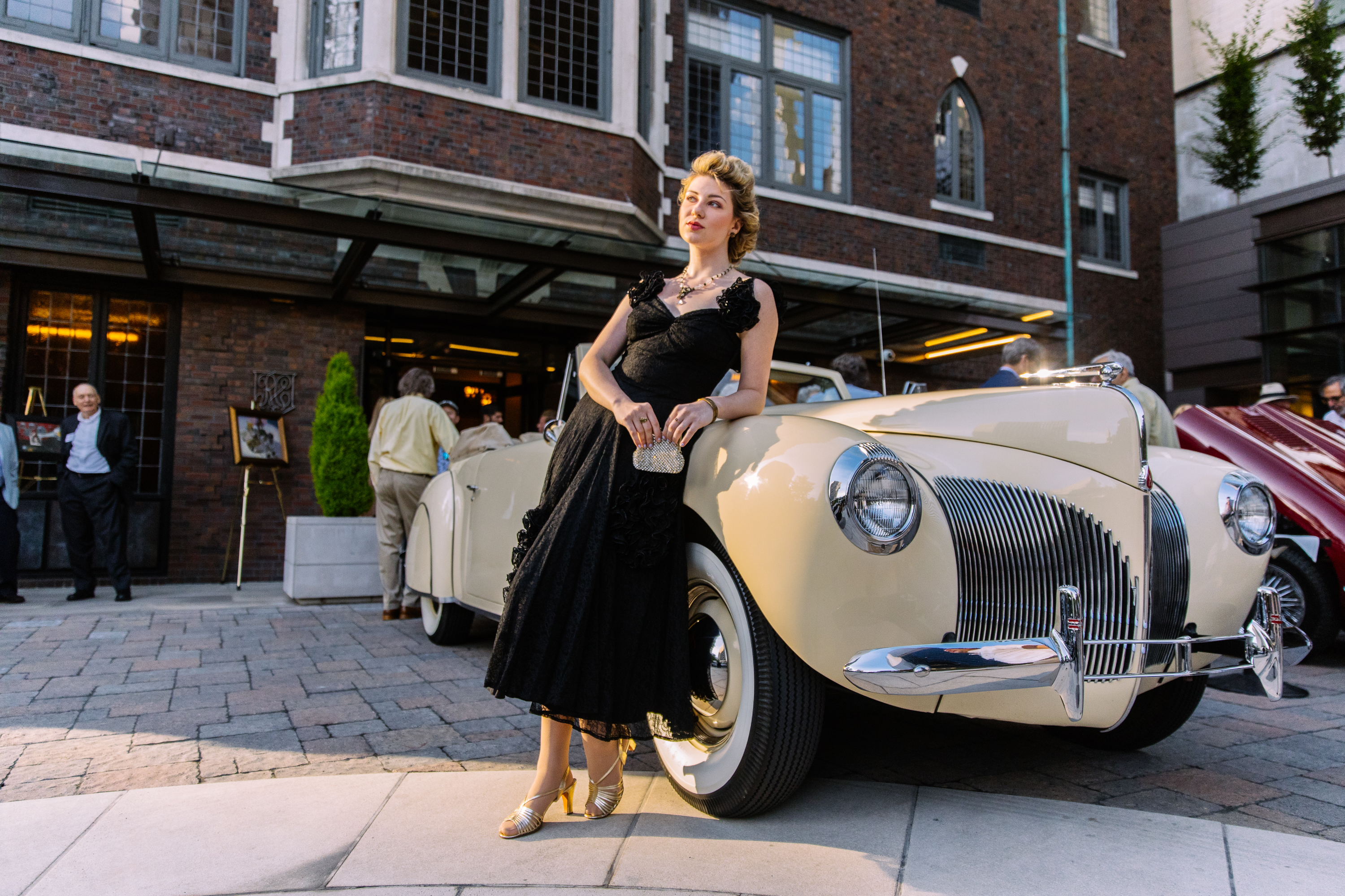 Seattle Goodwill volunteers model vintage fashion garments from the 1930s-1960s during the 'Classic Cars, Art, and Couture' event on Tuesday, July 16 at The Rainier Club. The Goodwill community engagement team matched clothing, shoes & accessories from Goodwill's Vintage Fashion Collection (VFC) with vintage cars. Goodwill's expansive VFC dates back to the 1850's. Artists from Gene Juarez Academy and Salons provided hair and makeup. (Photos: Seattle Goodwill)