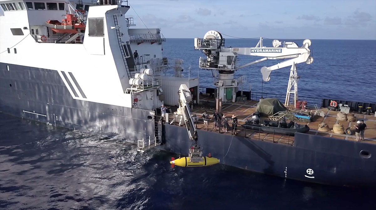 Photo from Paul Allen's research team shows the R/V Petrel lowering a remotely operated undersea vehicle into the ocean.<p></p>