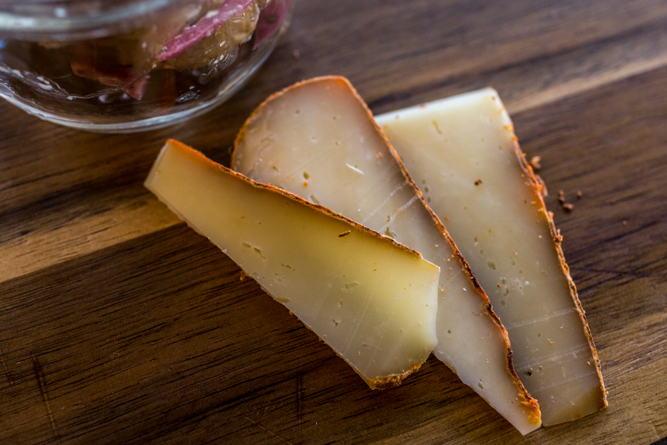 House-made Apollo cheese, a semi-hard cheese with paprika and olive oil rubbed on the rind and aged for at least two months / Image: Catherine Viox{ }
