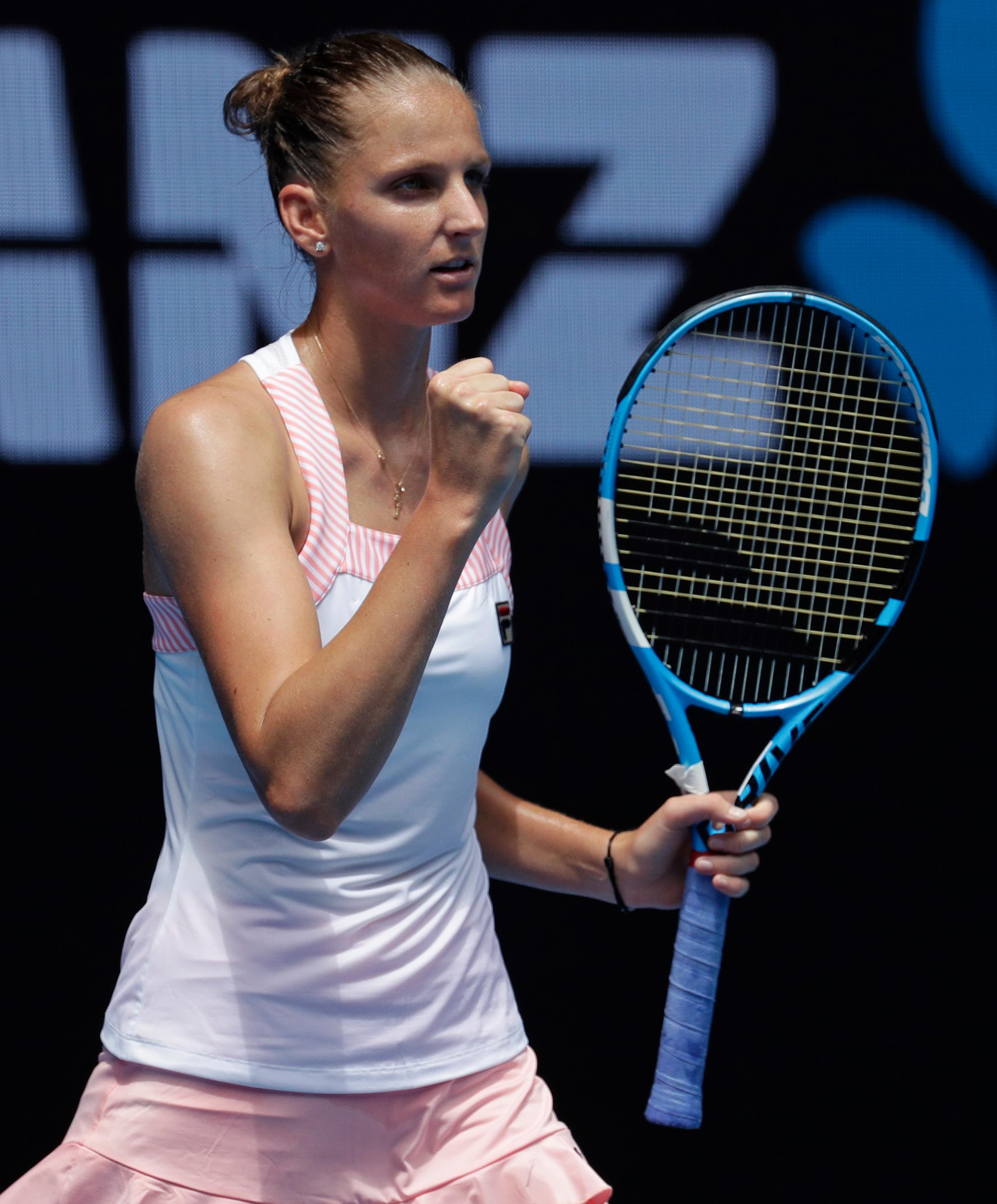 Karolina Pliskova of the Czech Republic celebrates after defeating compatriot Karolina Muchova in their first round match at the Australian Open tennis championships in Melbourne, Australia, Tuesday, Jan. 15, 2019. (AP Photo/Aaron Favila)