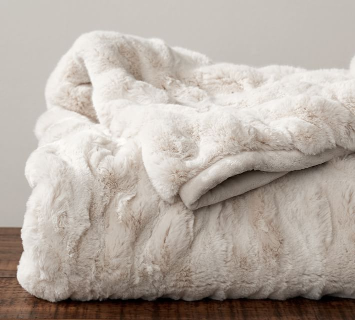The ultimate cuddle blanket.{ } Faux Fur Ruched Throws $ 88-200 (depending on size){ }(Image: Pottery Barn)