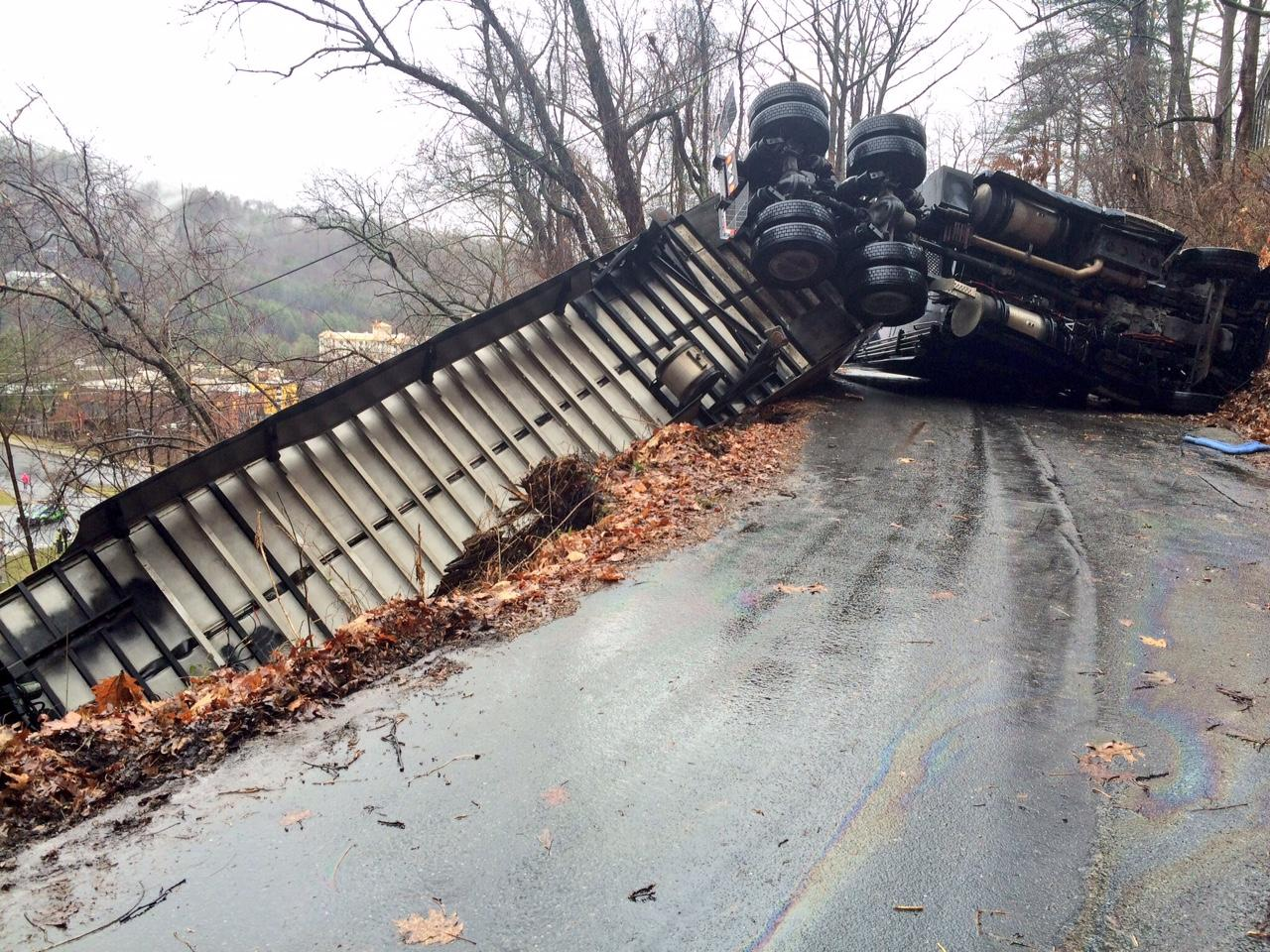 An overturned 18-wheeler has shut down Tunnel Road at the tunnel Monday morning. (Photo credit: WLOS staff)