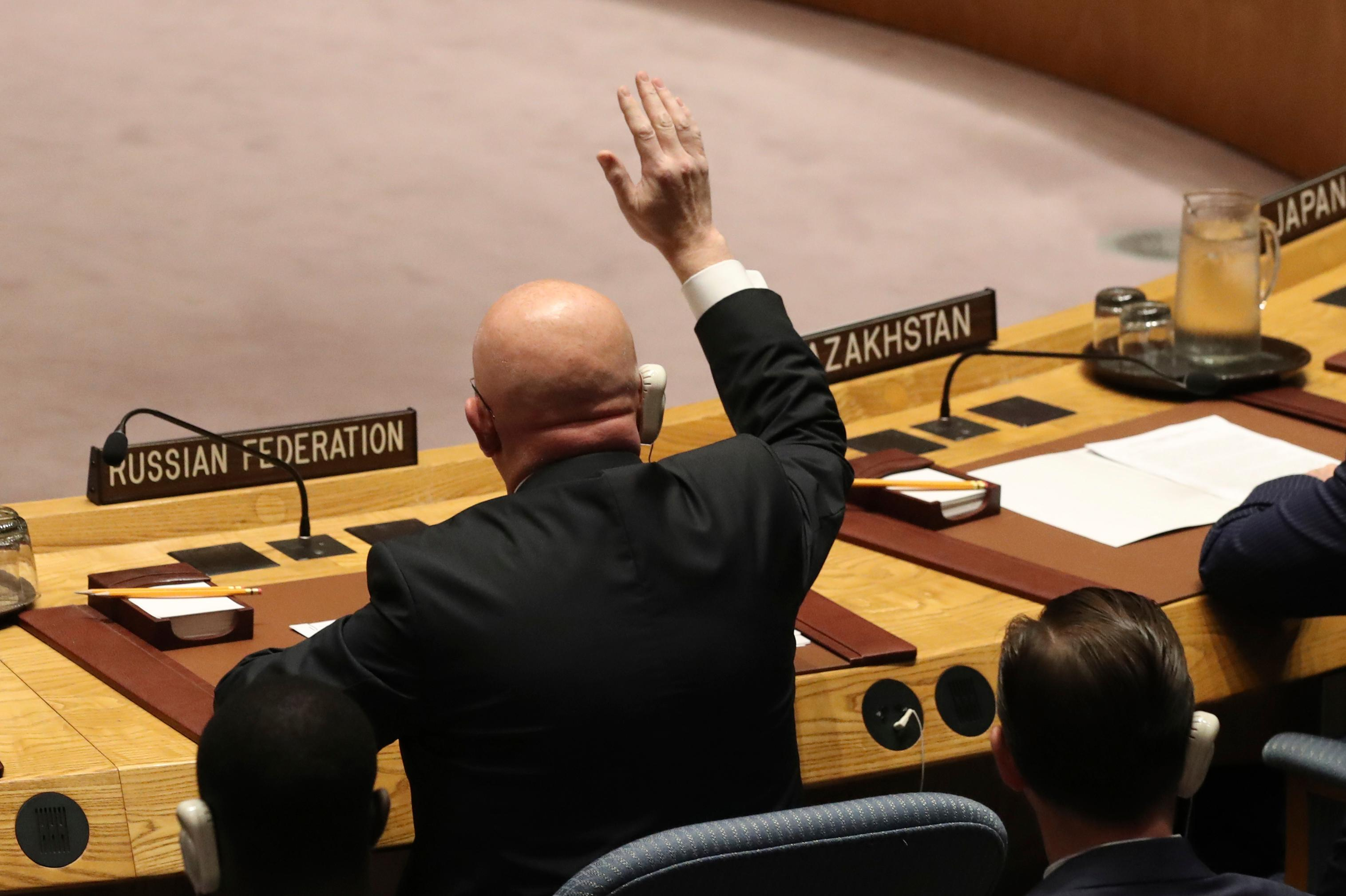 Russian Ambassador to the United Nations Vasilly Nebenzia votes during a Security Council meeting on a new sanctions resolution that would increase economic pressure on North Korea to return to negotiations on its missile program, Saturday, Aug. 5, 2017 at U.N. headquarters. (AP Photo/Mary Altaffer)
