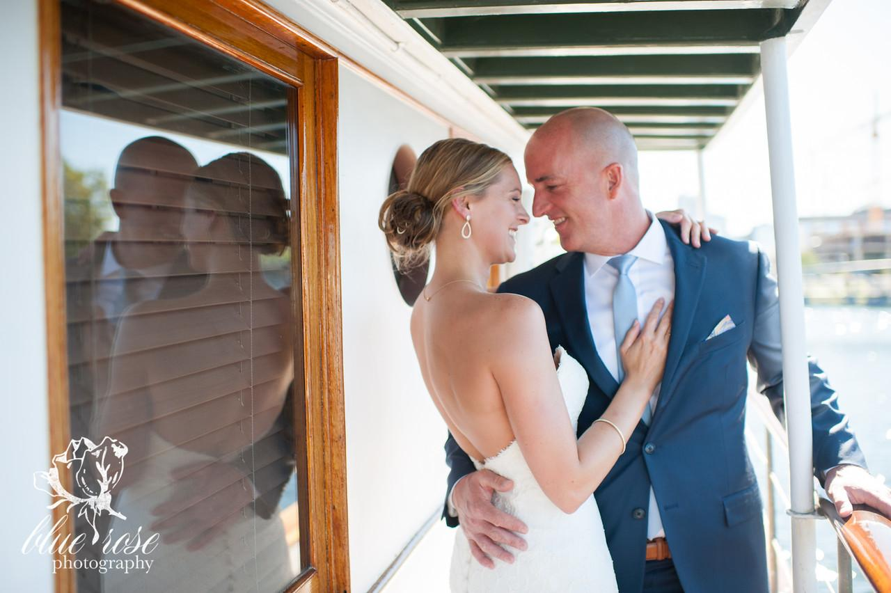 Sarah and Greg got married in September of 2014 while sailing on a vintage yacht through South Lake Union. The couple are huge foodies and brought on a personal chef to cook for their intimate wedding party - a close gathering of 25 guests. (Image: Blue Rose Photography)<p></p>