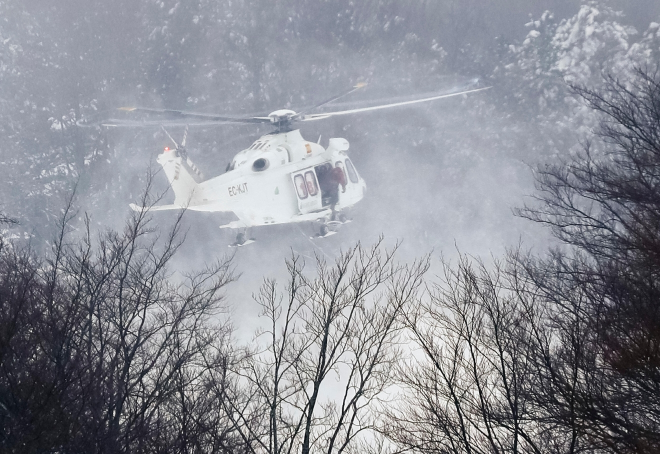 Rigopiano hotel avalanche first funerals as search goes on bbc news - A Rescue Helicopter Approaches The Area In Rigopiano Central Italy Where A Hotel Has