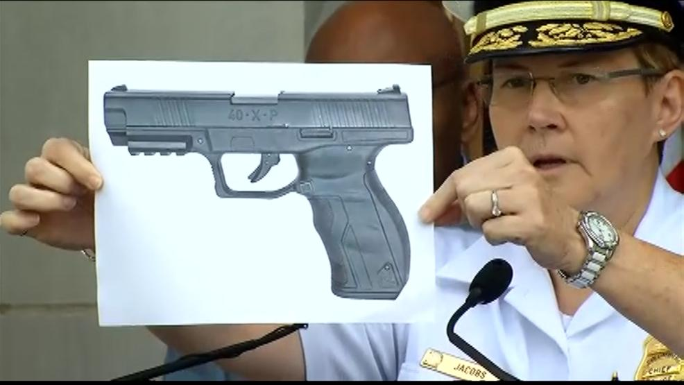Columbus Police Chief Kim Jacobs holds up a picture of a replica of the BB gun officers say Tyree King had when he was shot & killed. (WSYX/WTTE)