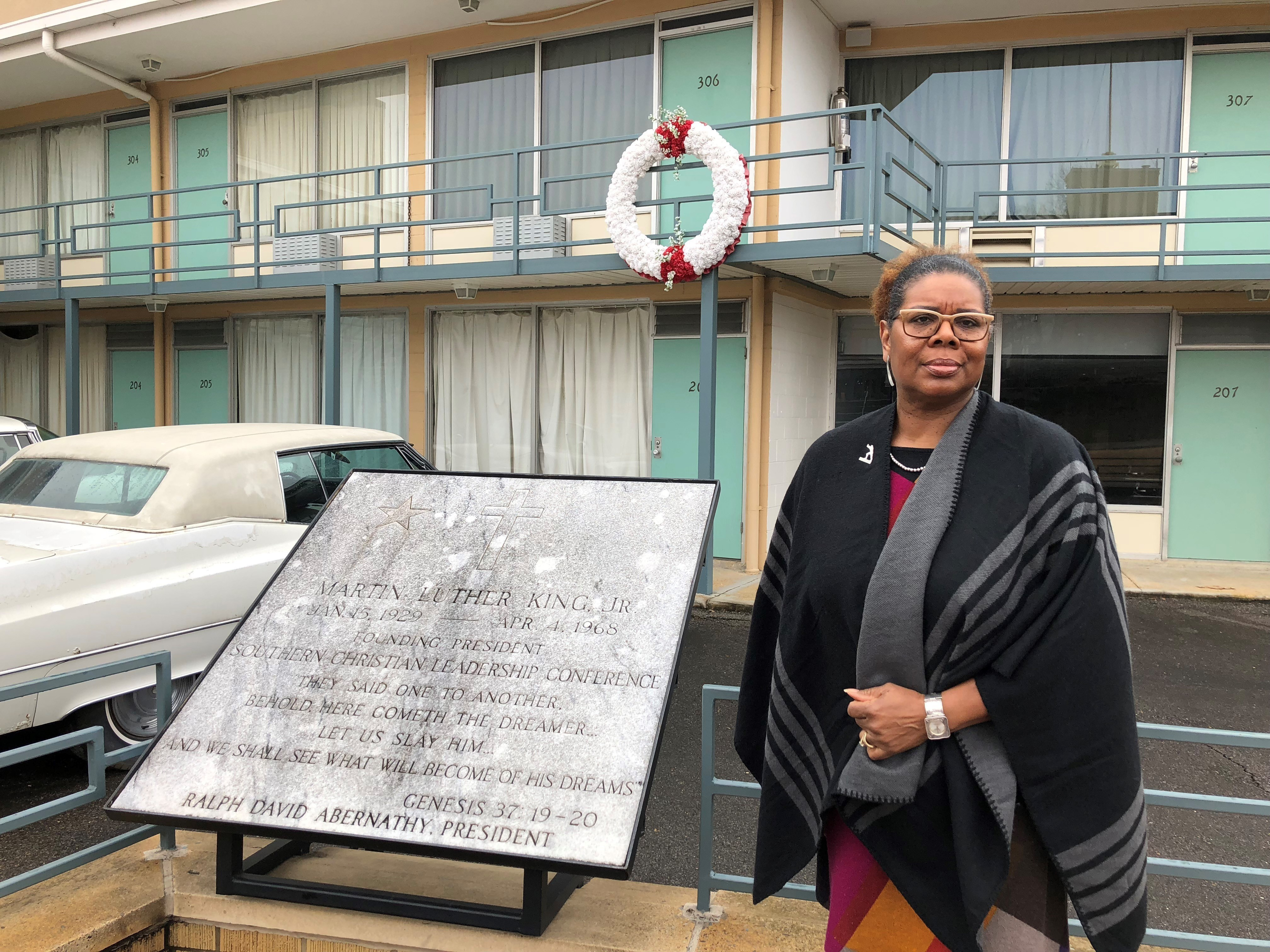 "National Civil Rights Museum President Terri Lee Freeman stands in front of the balcony of the old Lorraine Motel in Memphis, Tenn., Tuesday, Jan. 9, 2018, where Martin Luther King Jr. was fatally shot. When Dr. Martin Luther King Jr. said returning hate for hate multiplies hate, adding deeper darkness to a night devoid of stars, he wasn't thinking of the world in 2018. More than a half-century later, amid contentious political fights, one of King's memorable quotes from his book ""Strength to Love"" remains relevant.  (AP Photo/Adrian Sainz)"