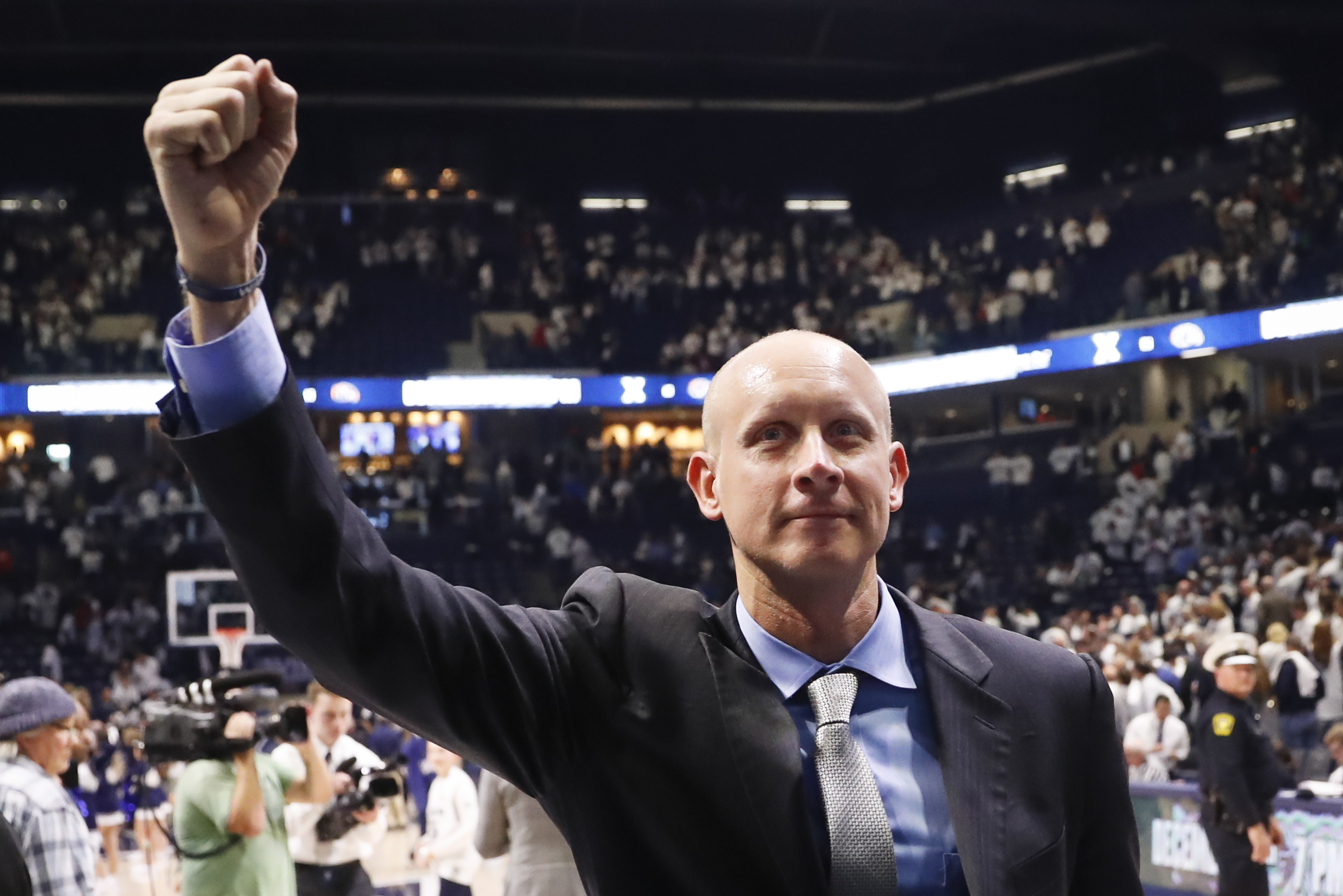 Xavier head coach Chris Mack celebrates after an NCAA college basketball game against Cincinnati, Saturday, Dec. 2, 2017, in Cincinnati. Xavier won 89-76. (AP Photo/John Minchillo)