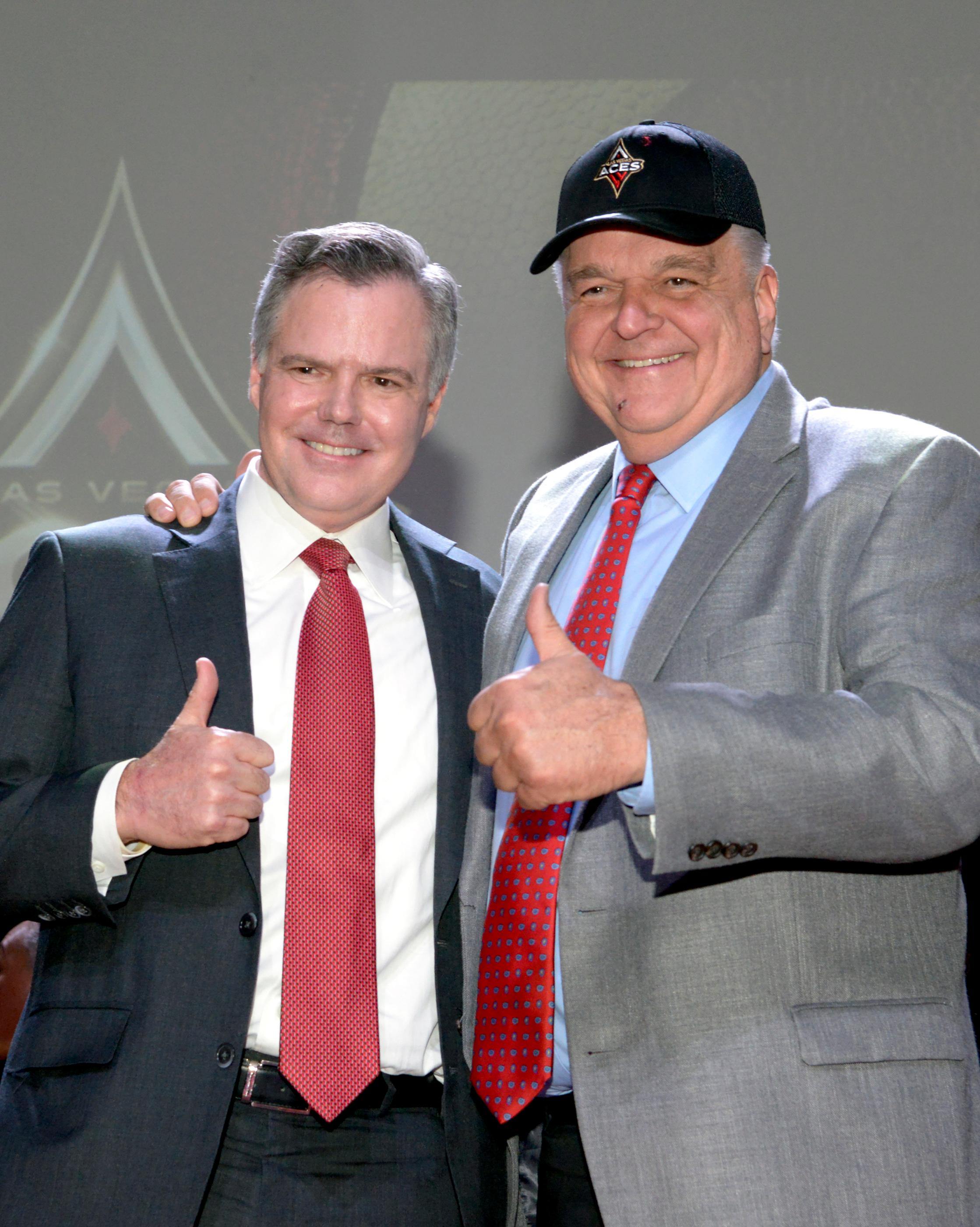 Jim Murren (l) Chairman and CEO of MGM Resorts International and Clark County Commissioner Steve Sisolak, wearing the new WNBA Las Vegas Aces hat pose during the press conference announcing Las Vegas' newest professional sports franchise at Mandalay Bay. Monday, December 11, 2017. CREDIT: Glenn Pinkerton/Las Vegas News Bureau