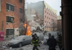 Firefighters work the scene of an explosion that leveled two apartment buildings in the East Harlem neighborhood of New York, Wednesday, March 12, 2014. (AP Photo/Jeremy Sailing)