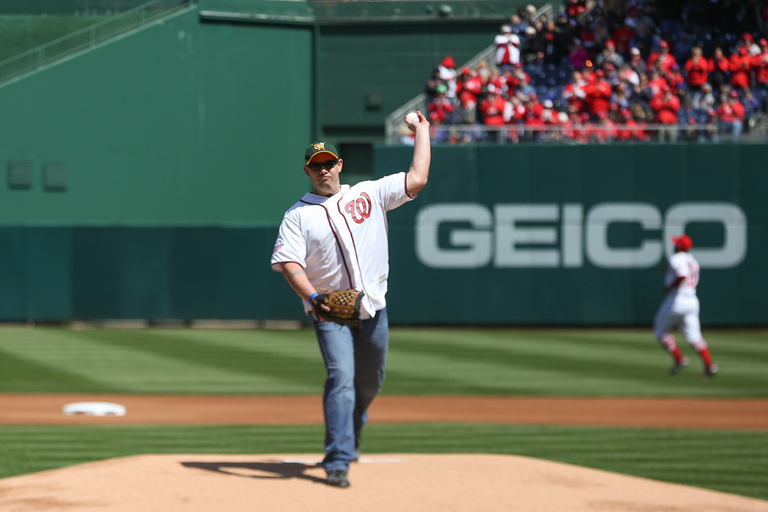The first pitch was thrown by{ }St. Mary's County, Maryland, Deputy Blaine Gaskill, who confronted a school shooter on May 20. (Amanda Andrade-Rhoades/DC Refined)