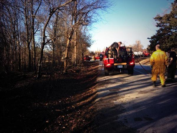 Fire crews quickly extinguished a wildfire near SE 29th and Triple X Road Sunday.