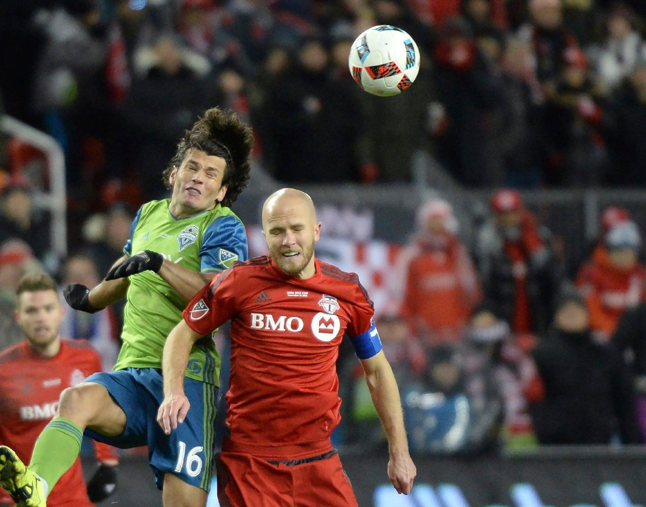 Seattle Sounders forward Nelson Valdez, left, and Toronto FC midfielder Michael Bradley vie for the ball during first half MLS Cup final soccer action in Toronto on Saturday, Dec. 10, 2016. (Nathan Denette/The Canadian Press via AP)