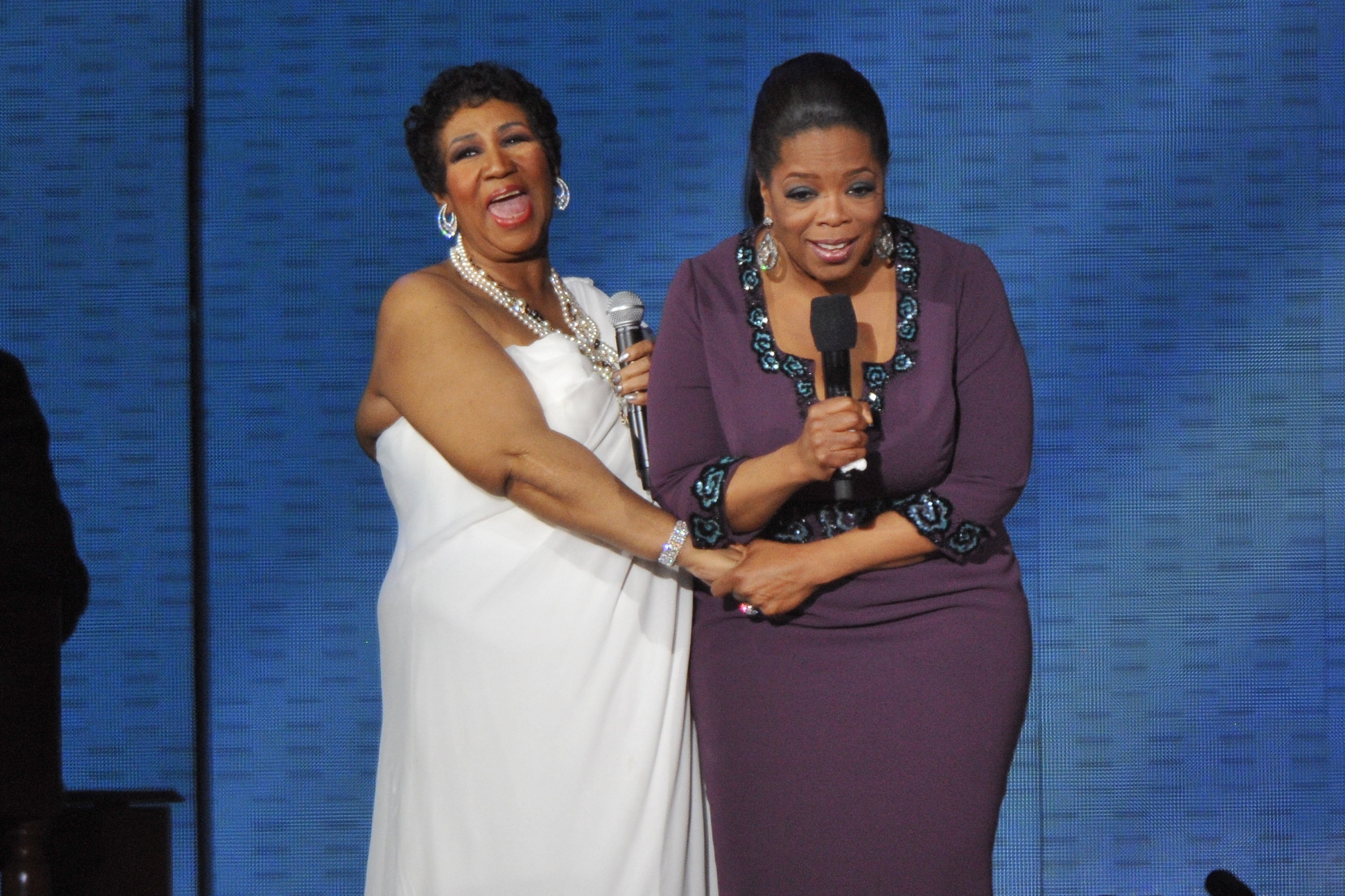 Aretha Franklin and{ }Oprah Winfrey during 'Surprise Oprah! A Farewell Spectacular' at the United Center in Chicago, Illinois. (When: May 17 2011. Credit: Ray Garbo/WENN.com)