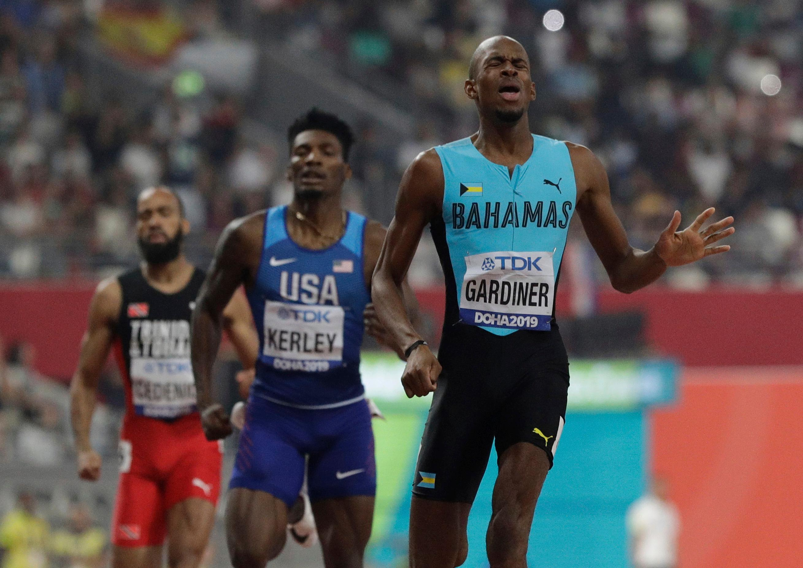 Steven Gardiner of Bahamas, right, wins the gold medal in the the men's 400 meter final at the World Athletics Championships in Doha, Qatar, Friday, Oct. 4, 2019. (AP Photo/Petr David Josek)