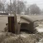 Melting snow reveals a mailbox graveyard in St. Joseph County