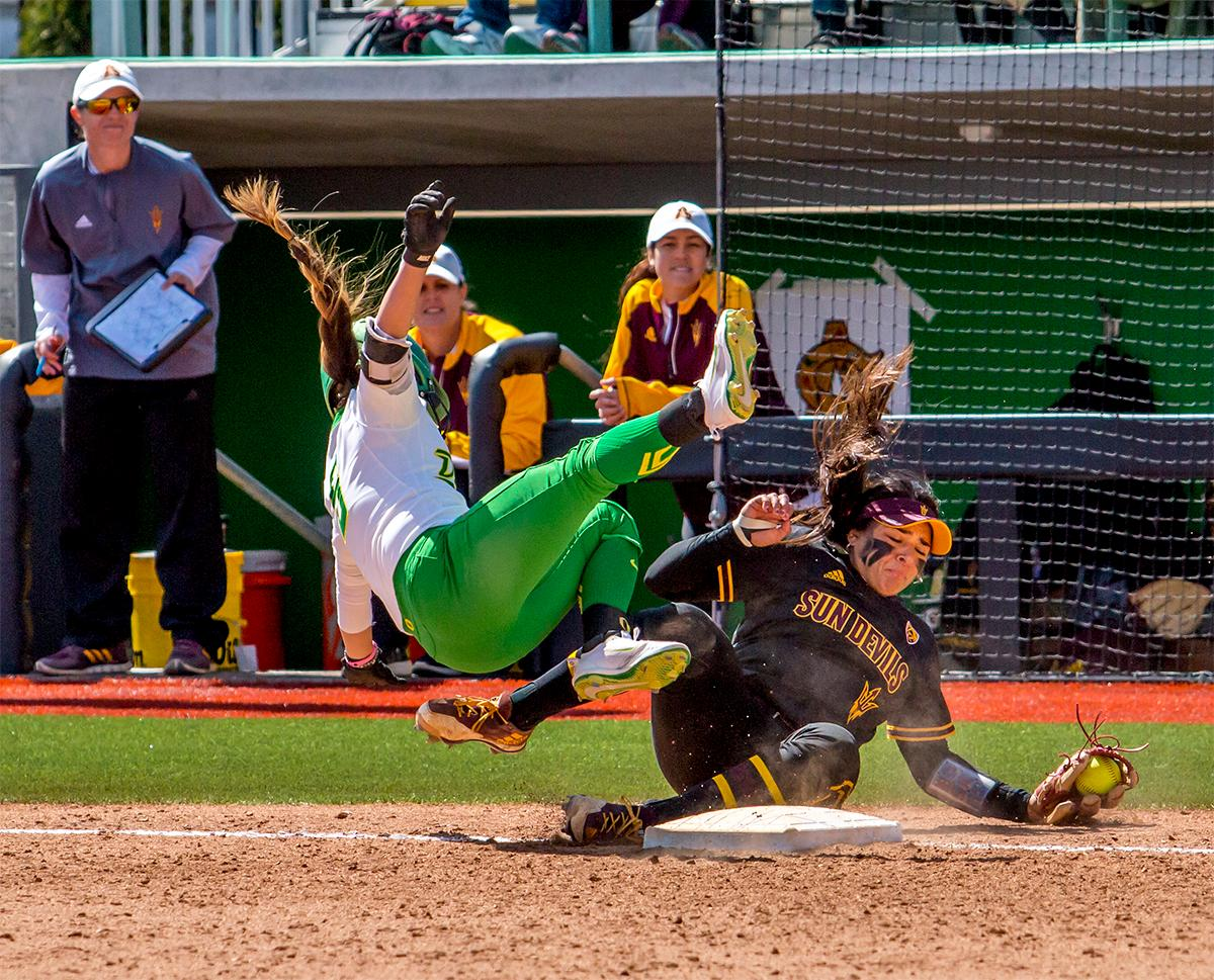 The Duck's Sammie Puentes (#5) collides with the Sun Devils' Marisa Stankiewicz (#20) and is sent to the ground. Puentes was soon helped off the field back to the Duck's Dugout. The Oregon Ducks Softball team took their third win over the Arizona Sun Devils, 1-0, in the final game of the weekends series that saw the game go into an eighth inning before the Duck?s Mia Camuso (#7) scored a hit allowing teammate Haley Cruse (#26) to run into home plate for a point. The Ducks are now 33-0 this season and will next play a double header against Portland State on Tuesday, April 4 at Jane Sanders Stadium. Photo by August Frank, Oregon News Lab