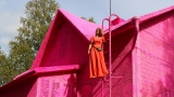 Artist covers 100-year-old house in pink crochet
