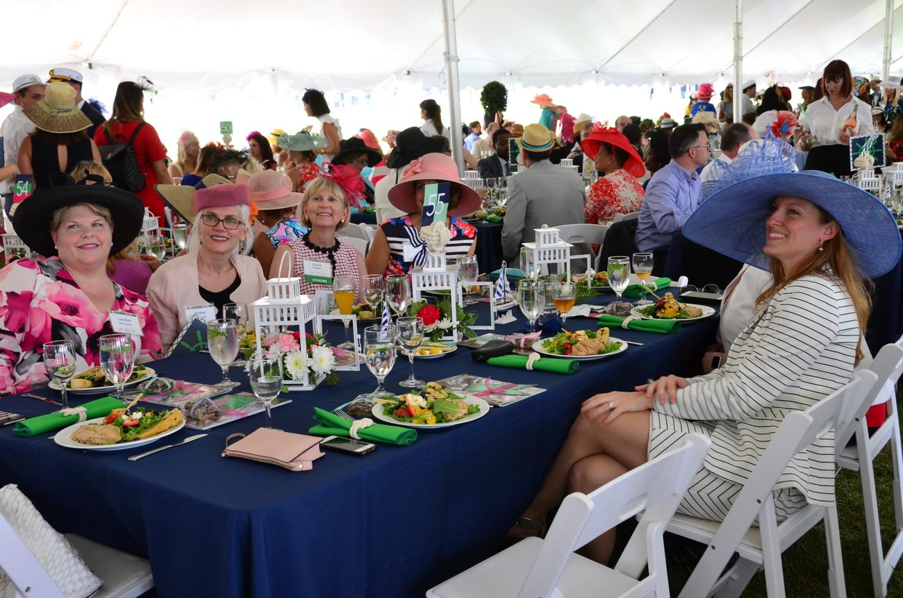"The 2018 Hats Off Luncheon took place on Thursday, May 17 at Smale Park. ""Rollin' on the River,"" the theme for the event, benefitted the Cincinnati Parks Foundation. The afternoon included a champagne reception, a Rozzie fireworks display, and a delicious chicken salad lunch. The mother-daughter duo of Marty & Jamie Humes co-chaired the event which welcomed over 1200 guests on a warm, but sunny day. / Image: Leah Zipperstein, Cincinnati Refined // Published: 5.18.18"