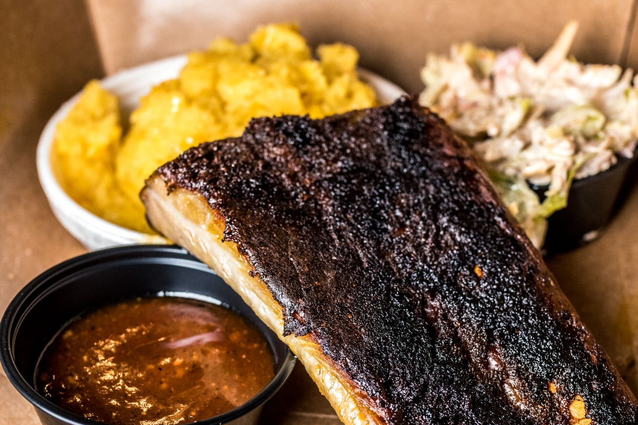Pair of St. Louis Style Ribs and a side of sweet corn spoon bread and slaw from Incline Smoke Shack / Image: Catherine Viox // Published: 8.28.20