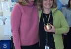 Golden Apple Award recipient Kelly Suda poses with FOX 11's Michelle Melby at Green Bay Preble High School, March 5, 2014. (WLUK/Don Steffens)