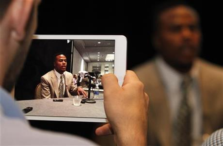 Alabama wide receiver Christion Jones, displayed on a tablet device, speaks to the media at the Southeastern Conference NCAA college football media days Thursday, July 17, 2014, in Hoover, Ala.