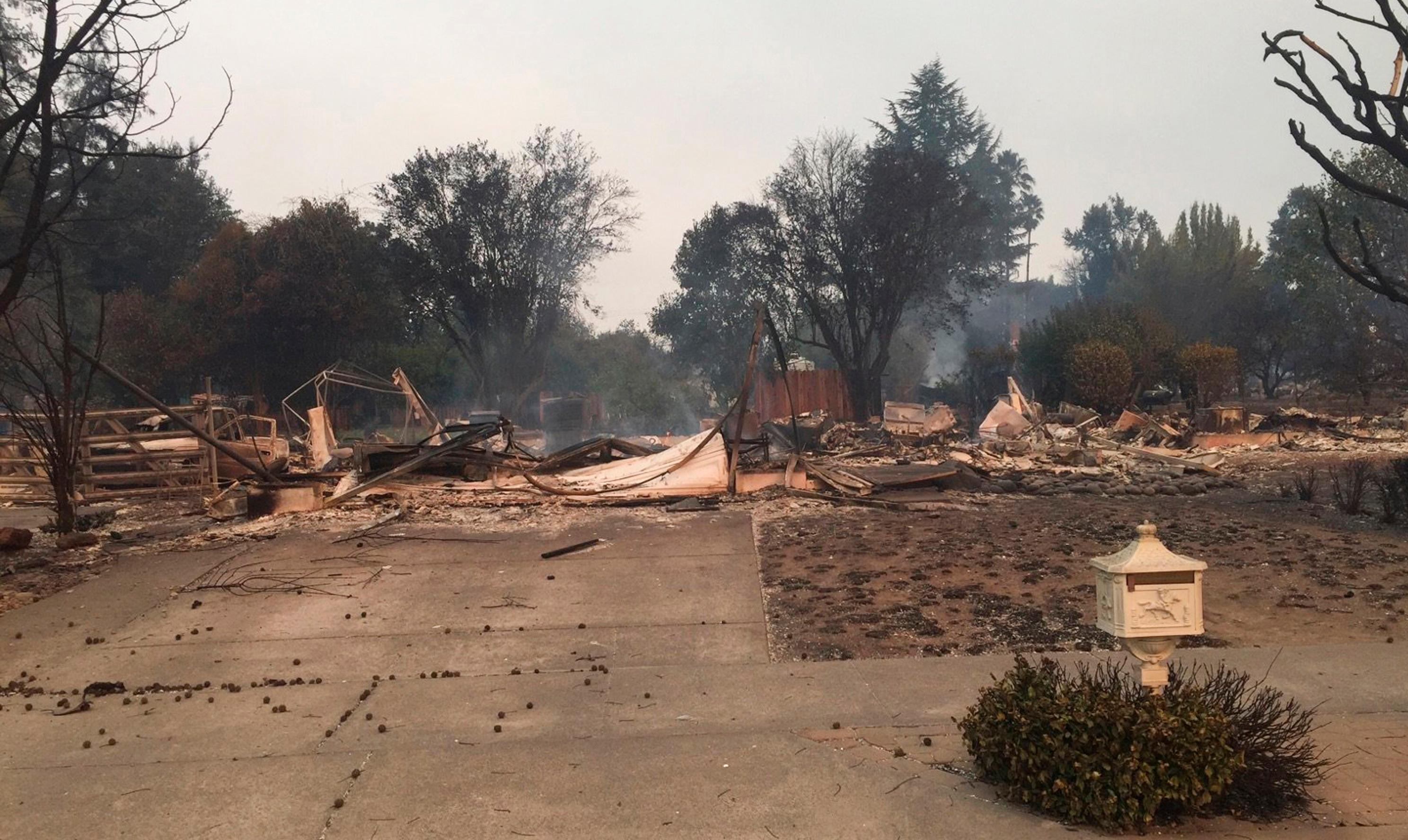 This Monday, Oct. 9, 2017, photo provided by Dominic Foppoli shows Jeff Okrepki's house leveled by a wildfire that tore through the Coffey Park subdivision of Santa Rosa, Calif. State authorities are deploying more firefighters and law enforcement officials to areas devastated by wildfires raging in Northern California. (Dominic Foppoli via AP)