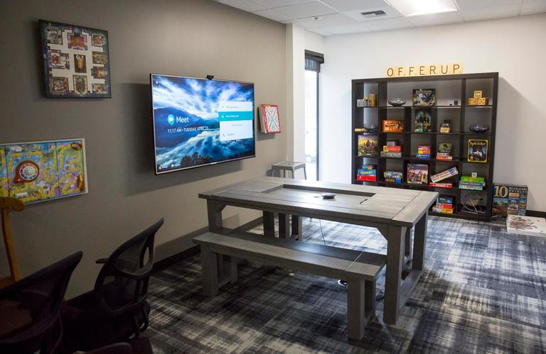 When OfferUp said they furnished their office with things they found on OfferUp - we HAD to check it out. Inspired by a little friendly competition, employees at OfferUp broke into teams and decorated each of the conference rooms with a certain theme, and the results were incredible! Over 70 cities from around the country are represented throughout the building, and the unique items - like the bottles in the Buffalo room that were sourced from remote locations around Washington State - are awesome. (Sy Bean / Seattle Refined)