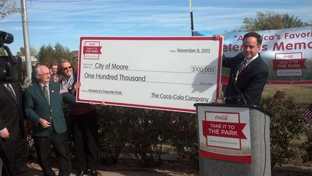 Coca-Cola presents the check for $100,000 to rebuild the park to the City of Moore's Mayor.The park received the check after winning a national contest.