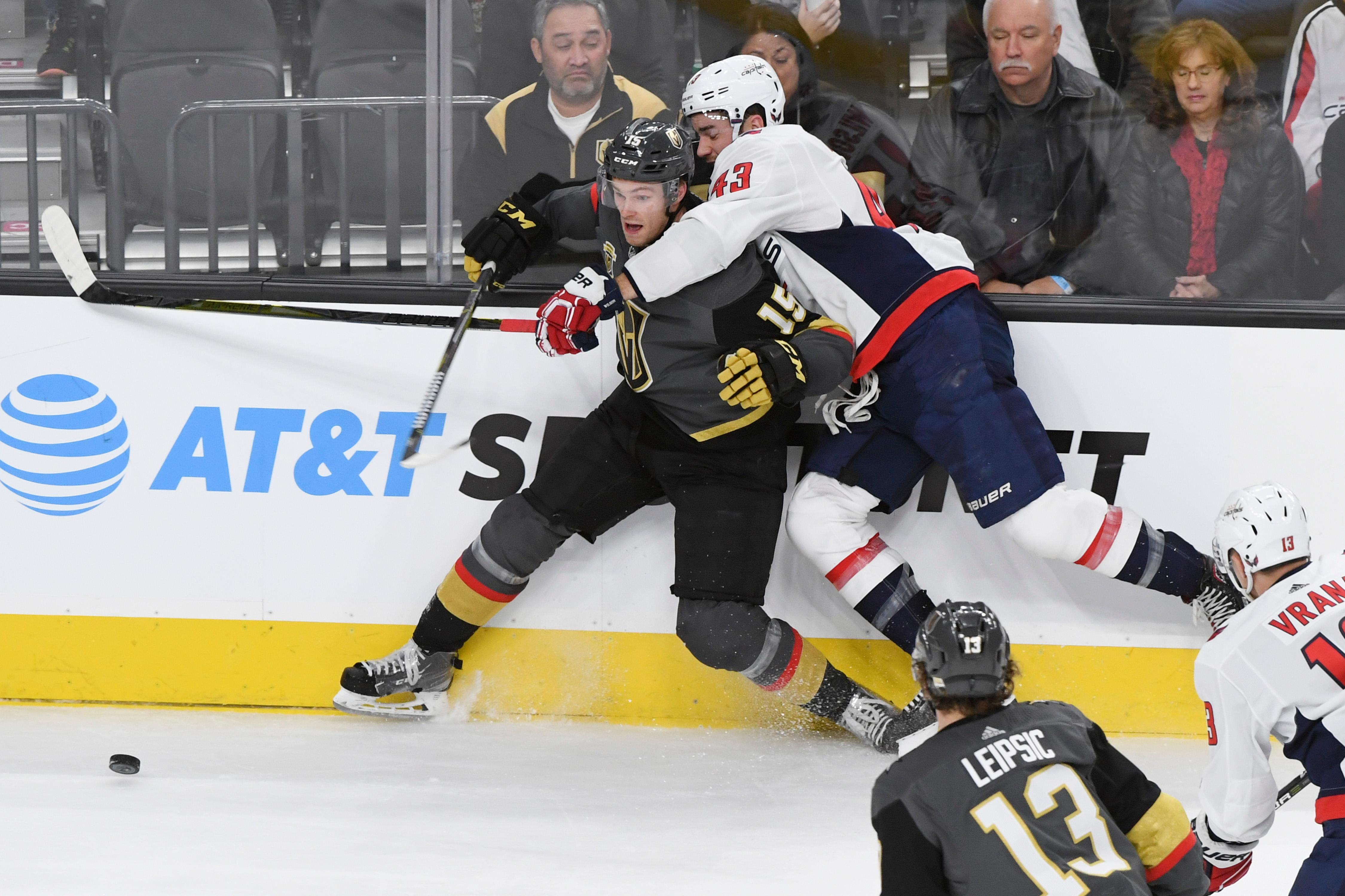 Washington Capitals right wing Tom Wilson (43) pulls Vegas Golden Knights defenseman Jon Merrill (15) into the boards during their NHL hockey game Saturday, December 23, 2017, at T-Mobile Arena in Las Vegas.  CREDIT: Sam Morris/Las Vegas News Bureau