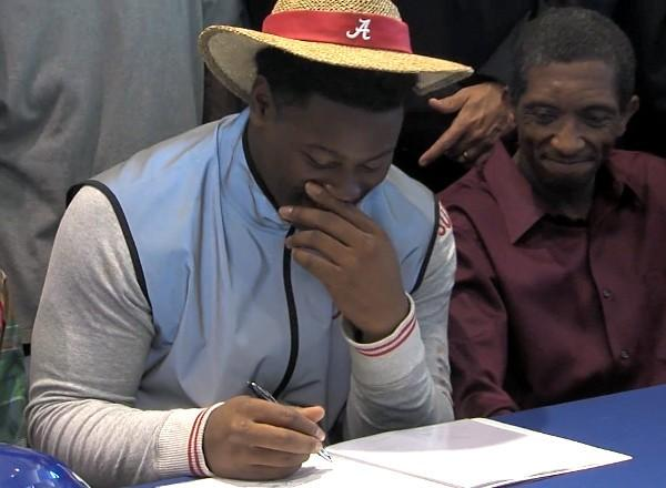 Auburn High linebacker Reuben Foster, dressed in Nick Saban-esque attire, signs his letter of intent to play football at the University of Alabama on National Signing Day Wednesday, February 6, 2013.