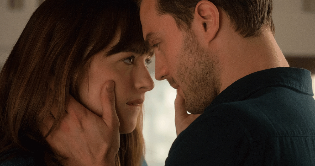 "Jamie Dornan (Christian Grey) and Dakota Johnson (Anastasia Steele) from a scene of ""Fifty Shades Darker."" 2017 Universal Pictures"
