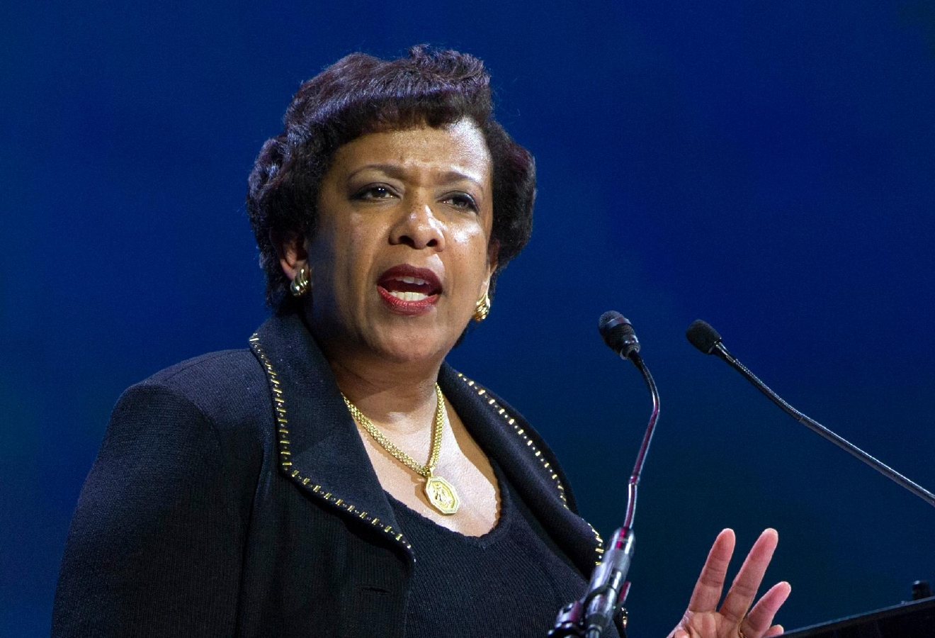 FILE - In this June 14, 2016 file photo, Attorney General Loretta Lynch speaks in Washington. Former President Bill Clinton spoke with Lynch during an impromptu meeting in Phoenix, but Lynch says the discussion did not involve the investigation into Hillary Clinton's email use as secretary of state. (AP Photo/Cliff Owen, File)