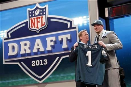 Lane Johnson, from Oklahoma, stands with NFL Commissioner Roger Goodell after being selected fourth overall by the Philadelphia Eagles in the first round of the NFL football draft, Thursday night.