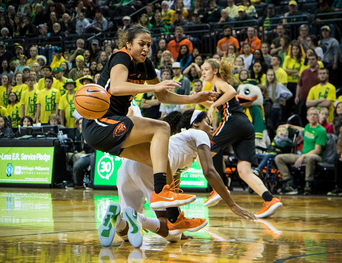 Oregon State Beavers Taya Corosdale (#5) attempts to get control of the ball. The Oregon Ducks defeated the Oregon State Beavers 75-63 on Sunday afternoon in front of a crowd of 7,249 at Matthew Knight Arena. The Ducks and Beavers split the two game Civil War with the Beavers defeating the Ducks on Friday night in Corvallis. The Ducks had four players in double digits: Satou Sabally with 21 points, Maite Cazorla with 16, Sabrina Ionescu with 15, and Mallory McGwire with 14. The Ducks shot 48.4% from the floor compared to the Beavers 37.3%. The Ducks are now 7-1 in conference play. Photo by Rhianna Gelhart, Oregon News Lab
