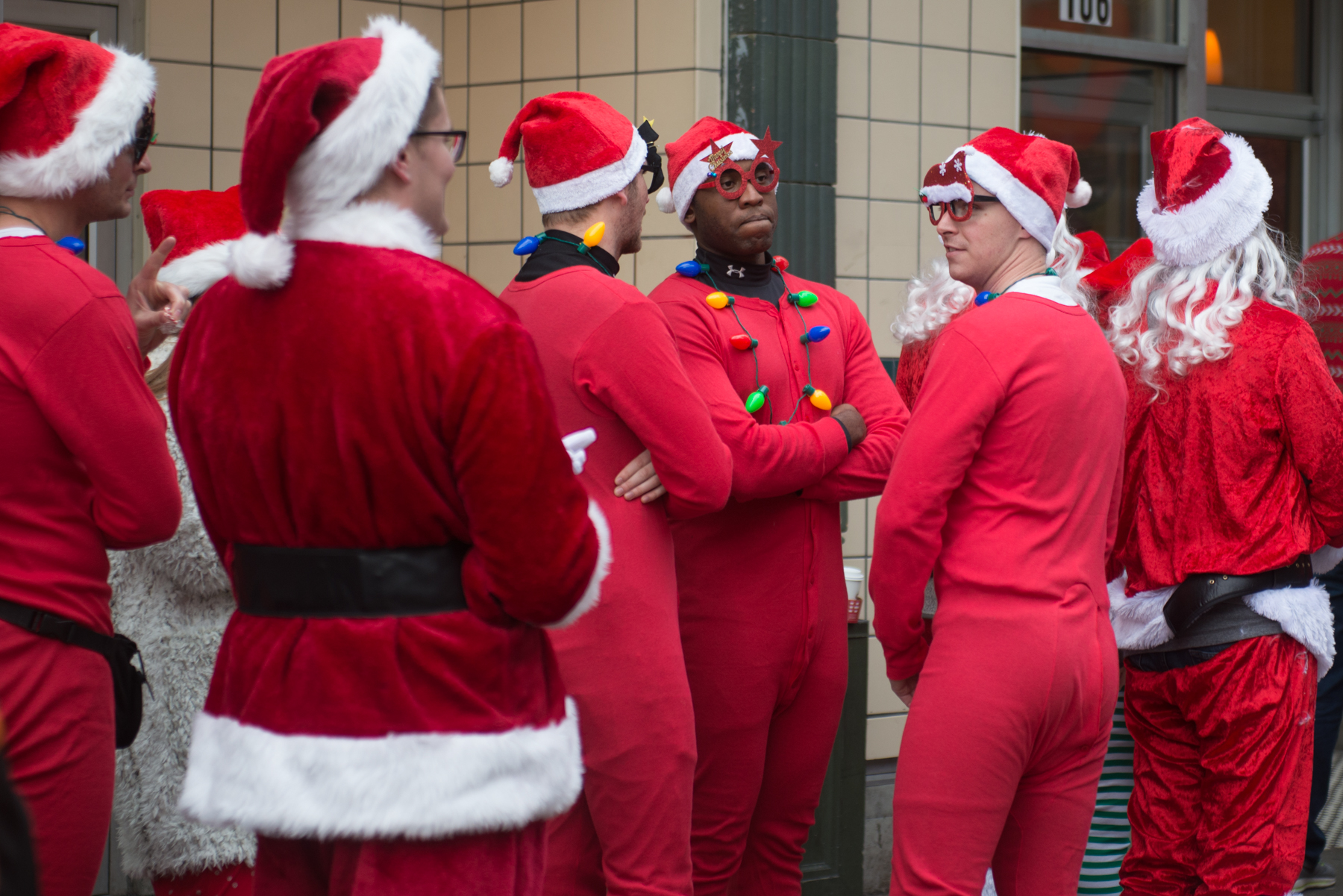 "Thousands of Santas flooded the streets of Seattle for the annual Seattle Santa Con. Hundreds of people packed bars downtown in Santa, Elf and Reindeer attire. The focus is on spontaneity and creativity, while having a good time and spreading cheer and goodwill. and their #1 rule? ""My name is Santa. Your name is Santa. We are Santa. Who's in charge here? Santa!"" (Image: Chona Kasinger / Seattle Refined)"