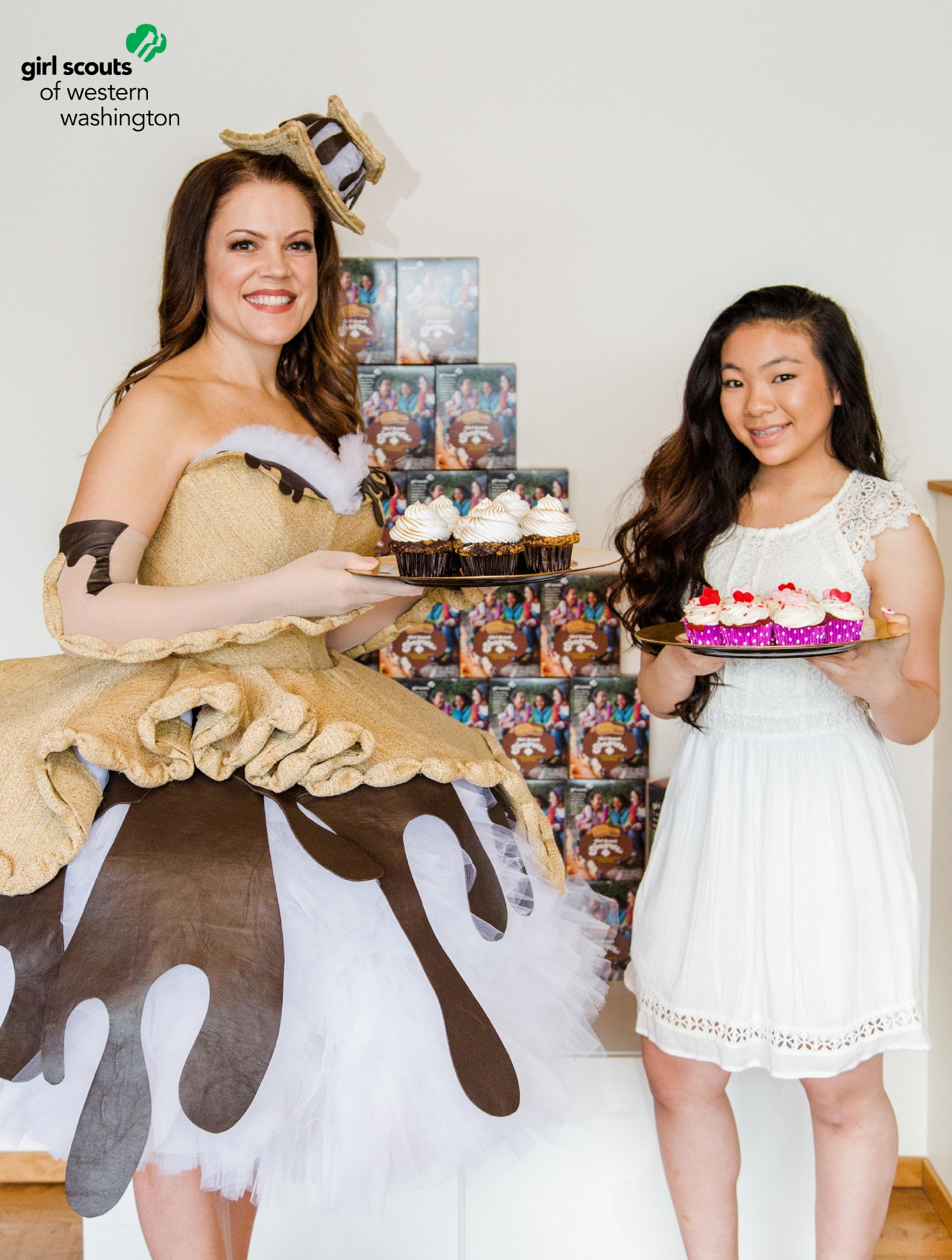 Trophy Cupcakes entrepreneur and Girl Scout alumna, Jennifer Shea models the dress along with Melody Nguyen, Girl Scout and Cupcake Wars/Chopped Junior contestant.  This duo was paired due to their love of cupcakes and because Nguyen hopes to achieve the same level success as Shea in the culinary arena.  Photo Credit: David Jaewon Oh
