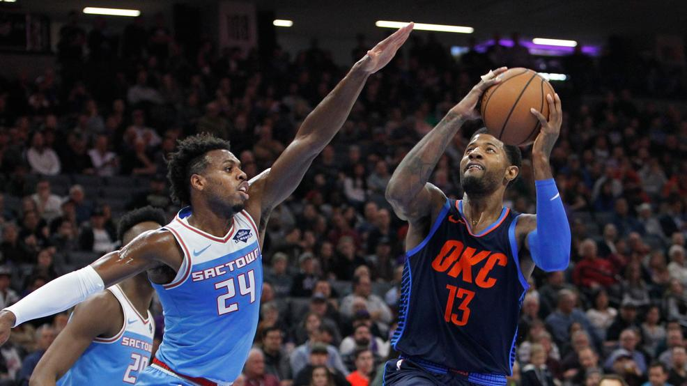 Oklahoma City Thunder forward Paul George (13) shoots over Sacramento Kings  guard Buddy Hield (24) during the first half of an NBA basketball game in  ...