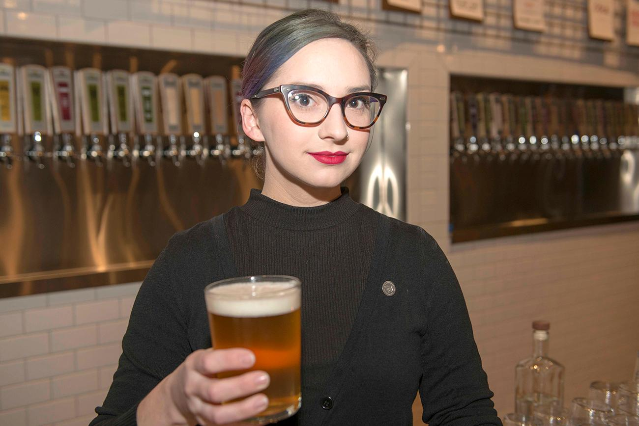 Madeline Winters (bartender) with a glass of Pilsner{ }/ Image: Joe Simon // Published: 1.9.19