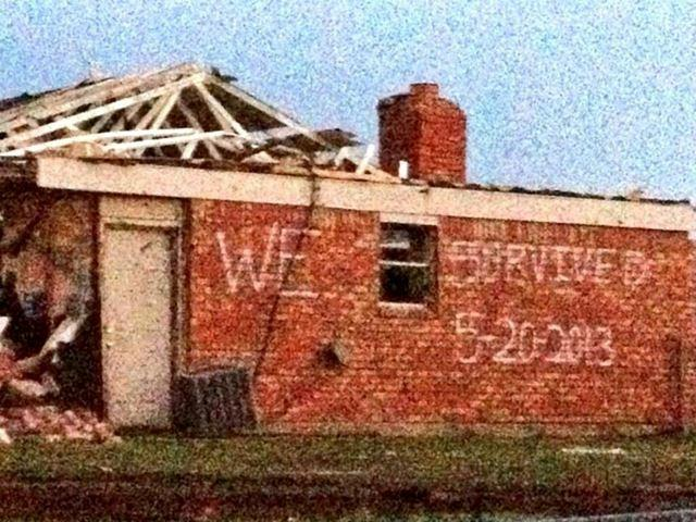 "Written on the side of a house in Moore immediately after the storms: ""We survived 5-20-2013"""