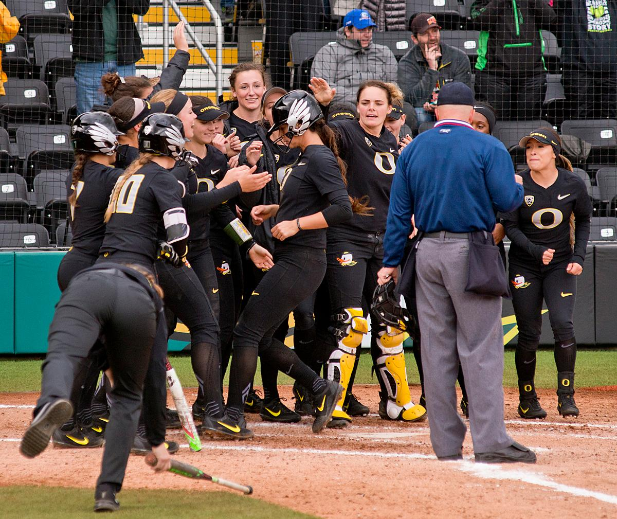 Oregon Ducks Nikki Udria (#3) is congratulated by her teammates after hitting a homerun against the California Golden Bears. The Ducks defeated the Golden Bears 2-1 in game two of a three-game series. Photo by Dan Morrison, Oregon News Lab
