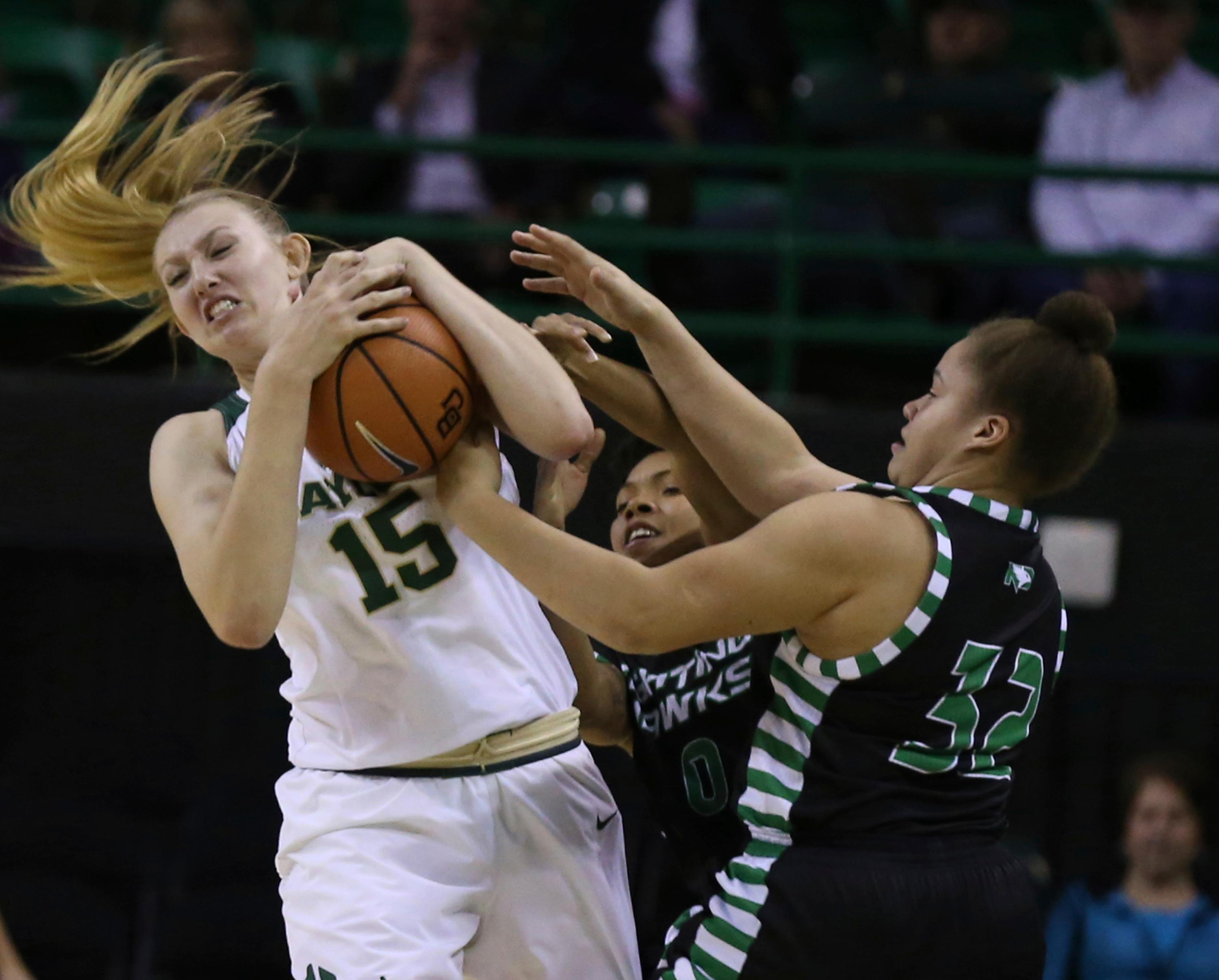Baylor forward Lauren Cox, left, pulls down a loose ball over North Dakota Akealy Moton, right, during the first half of an NCAA college basketball game Tuesday, Dec. 5, 2017, in Waco, Texas. (Rod Aydelotte/Waco Tribune Herald, via AP)
