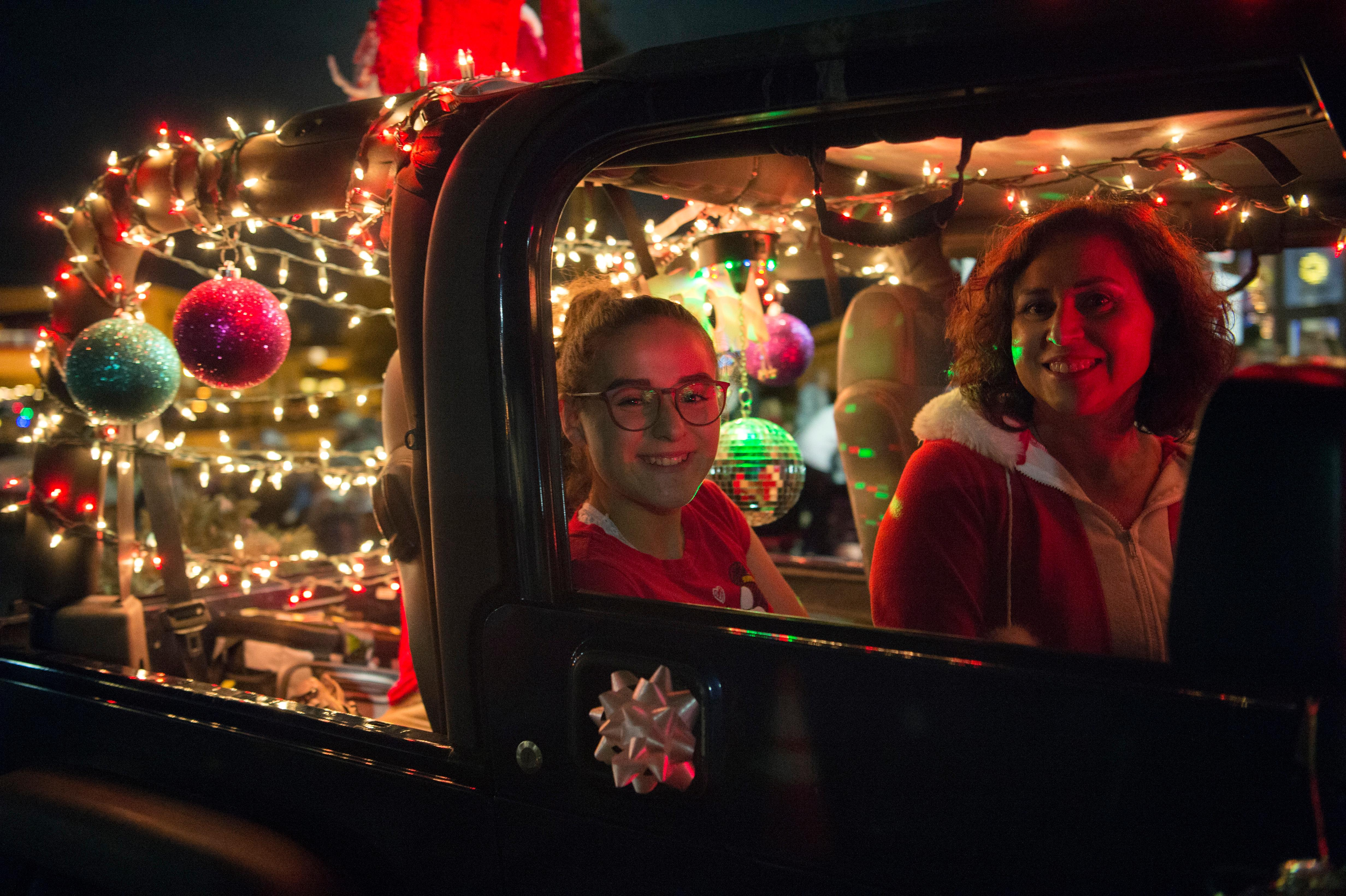 Passengers in a truck are illuminated by Christmas lights during the Santa's Electric Parade Saturday, December 2, 2017, in Boulder City. [Sam Morris/Las Vegas News Bureau]